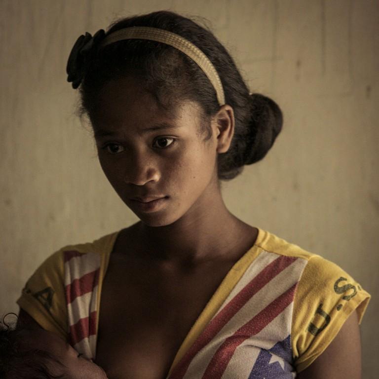 Tafitasoa (19yrs) feeding baby, Madagascar GOLD show 2014